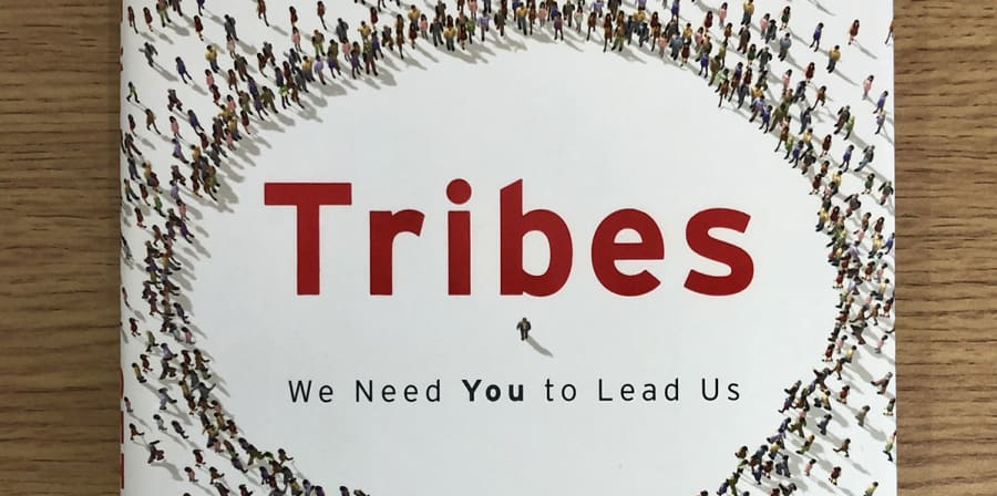 The book jacket of Tribes, which features a graphic of a crowd.