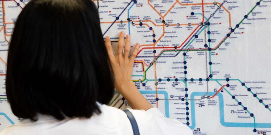 Woman reading London underground map