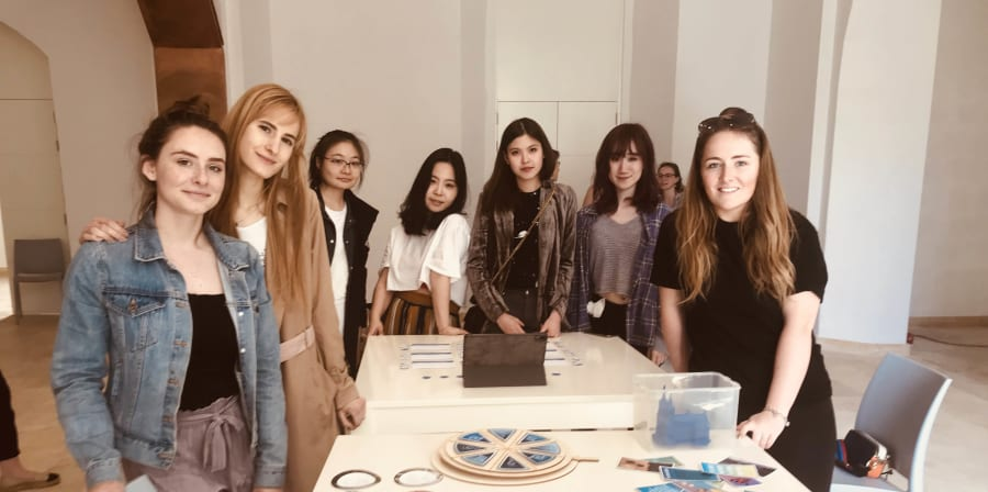Group of students standing next to their work as part of Futurising in the Museum project