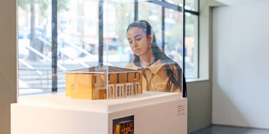 Girl examining an exhibit at a summer show
