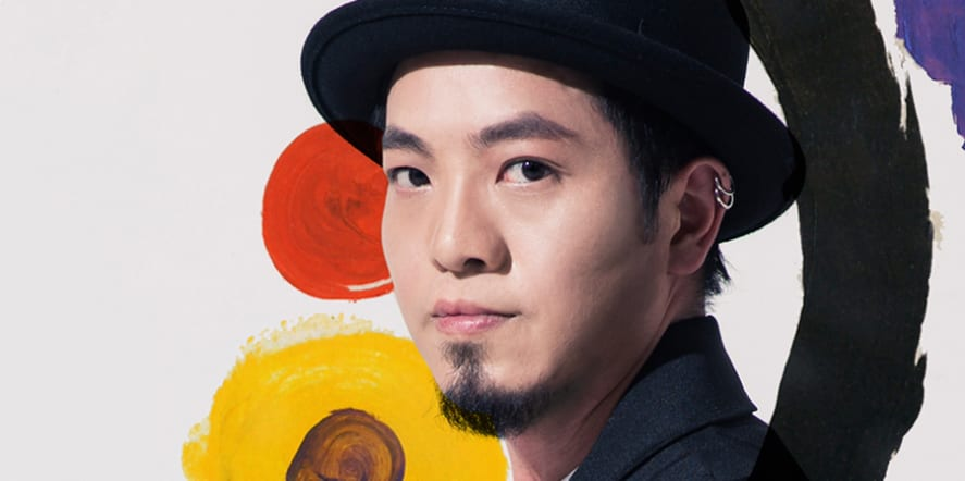 Portrait photo of a man in a bowler hat, looking to camera, with painted circles