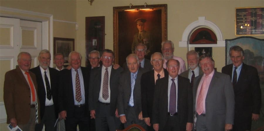 The group celebrates in the Queen Victoria Rifles' London Mess.