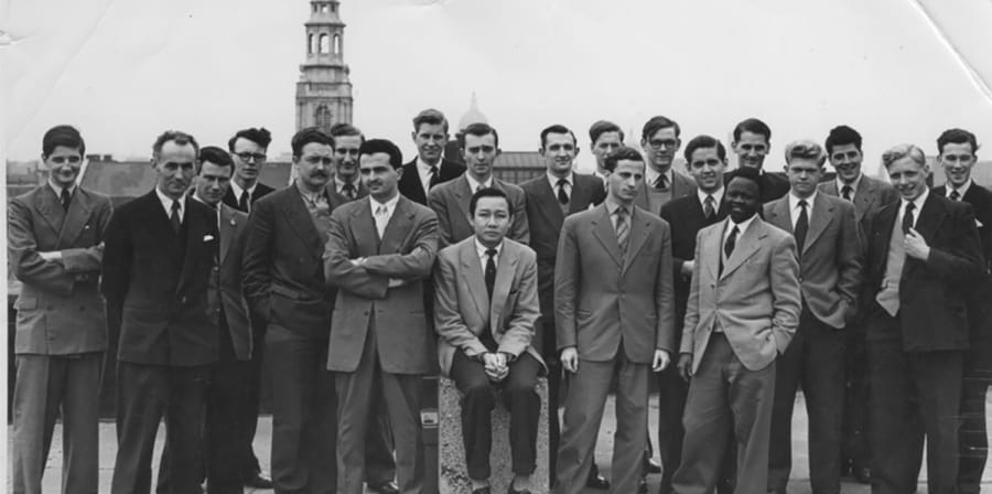 A black and white image of the group on a rooftop in 1956.
