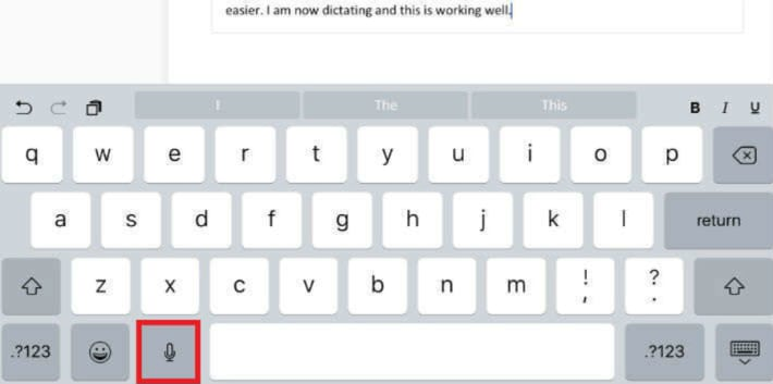 Screenshot of the Free Dictation option on an iPhone keyboard