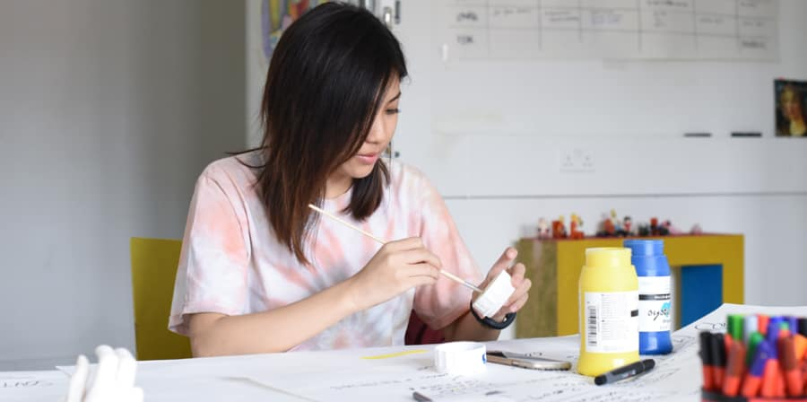 Woman using a paint brush