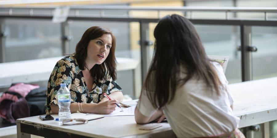 A student receiving CV advice