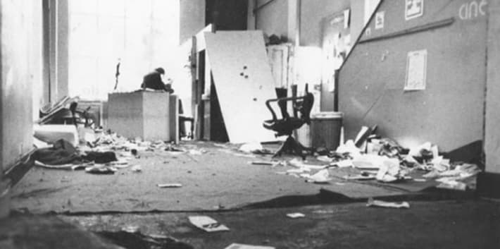 A black and white photograph of the inside of a studio