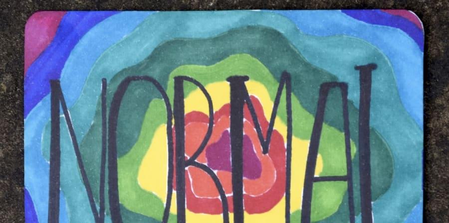 Circular rainbow coloured postcard design with