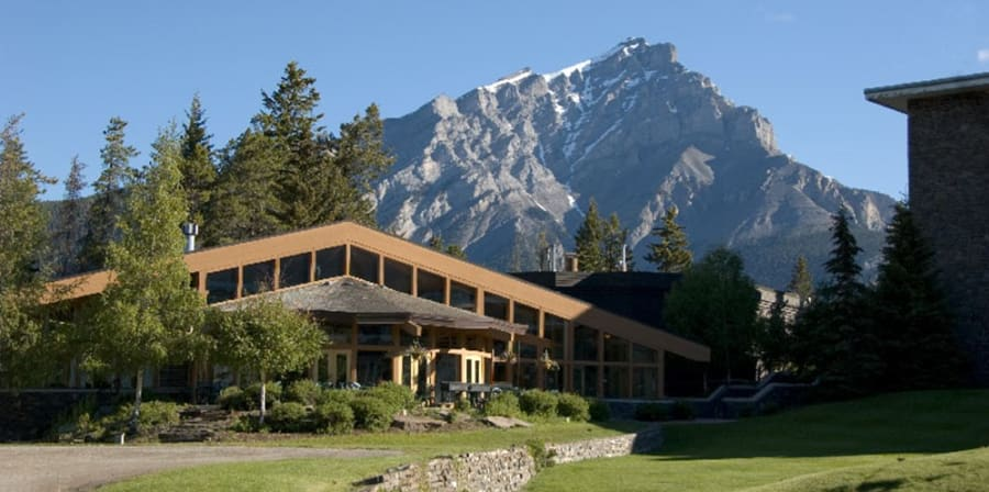 Image of blue sky and Banff art centre building in front
