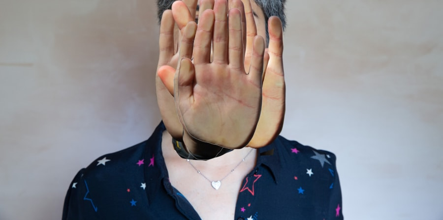 Photograph of a woman with hands collaged over her face