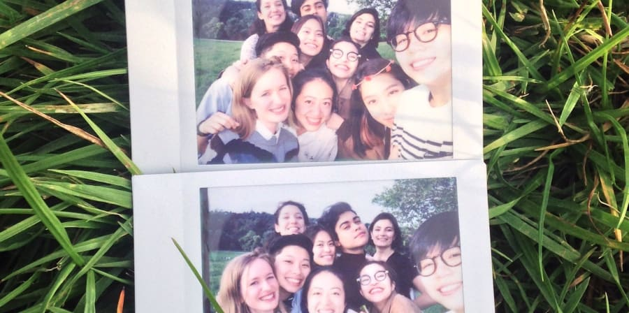 Polaroid of a smiling group of students