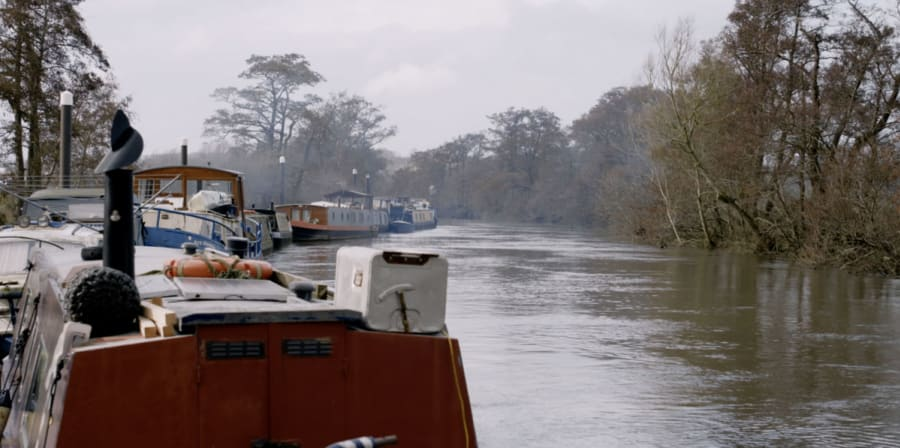 Still of a boat on a serene canal.