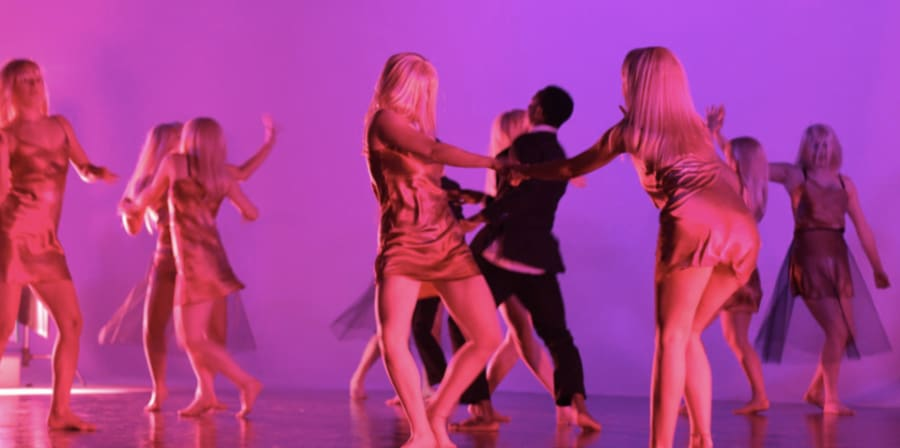 Pink-light in space with dancers