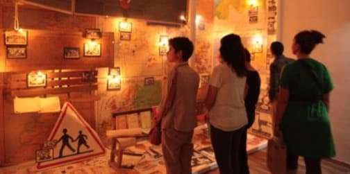 A group of people looking at a display lit in yellow light