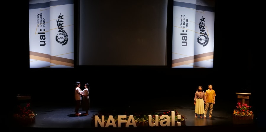 Performers on stage at ceremony, with UAL and NAFA logos in the background