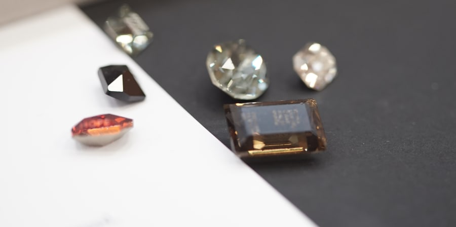 Close up of engraved Swarovski crystals used in Imogen Burgh's rings
