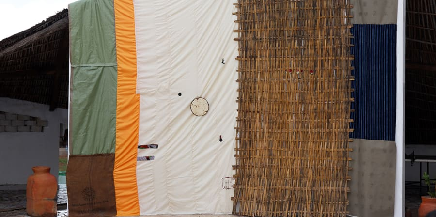side of a makeshift building covered in fabric and weaved material
