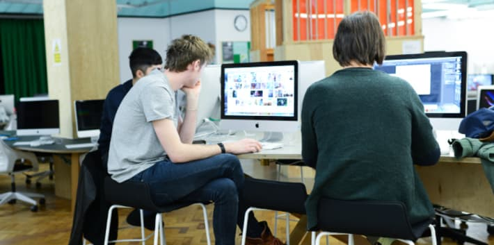 London College of Communication students sitting at iMacs