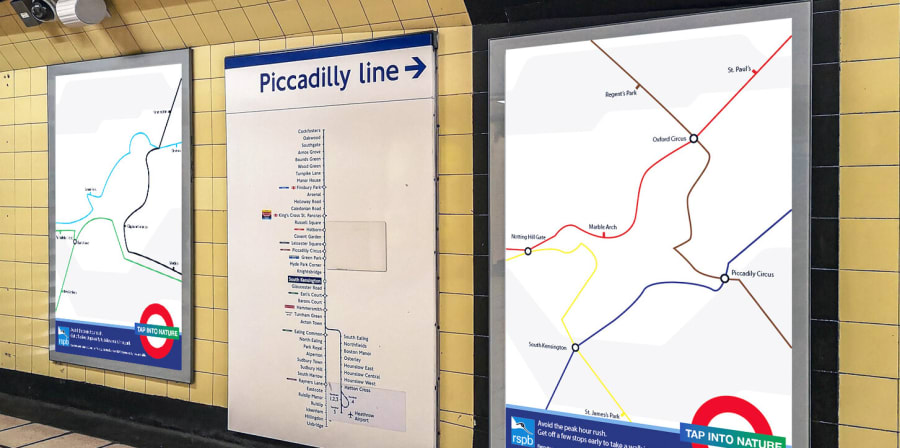 Tube maps shaped like birds are mocked up in an Underground Station.