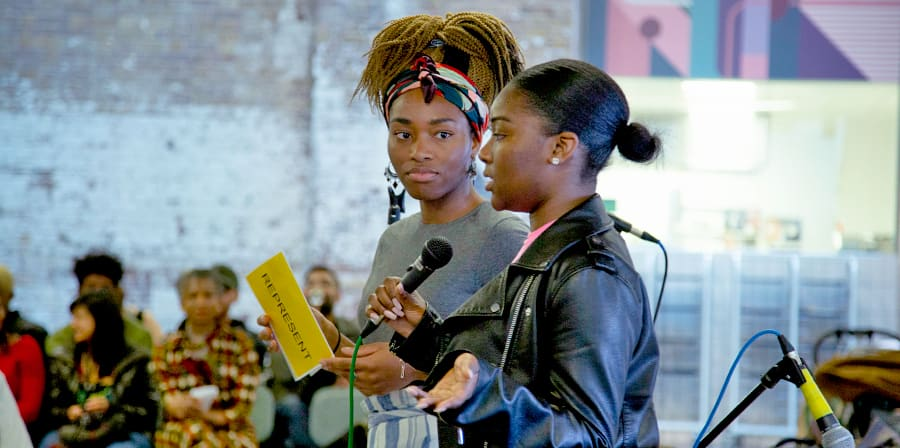 Two black female speakers at the CSM Zine 1 launch at UAL in 2019