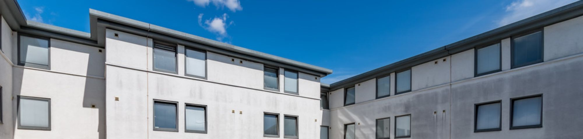 Exterior shot of the courtyard at Don Gratton house