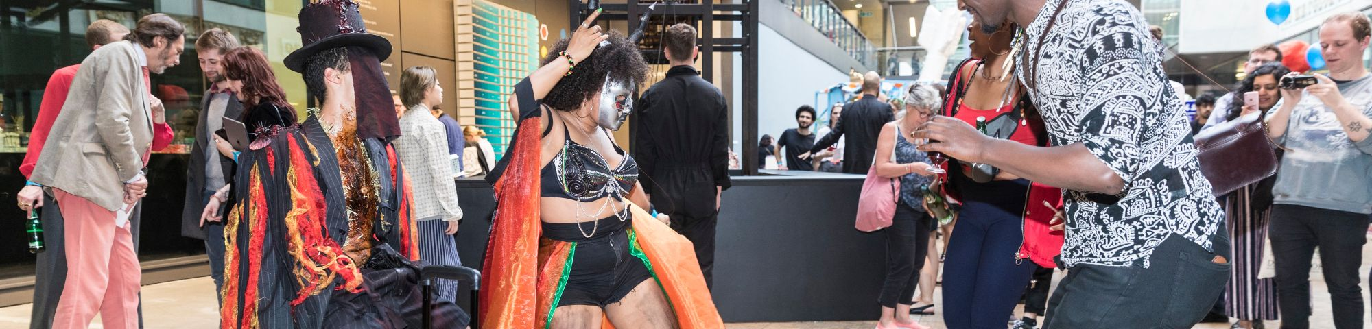 People dancing wearing carnival inspired clothing.