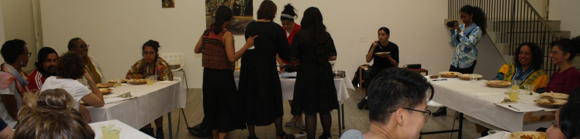 photo of people sharing a meal in the gallery