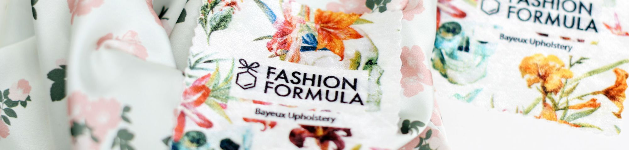 Piece of colourful material on a table with 'Fashion Formula' printed on the label