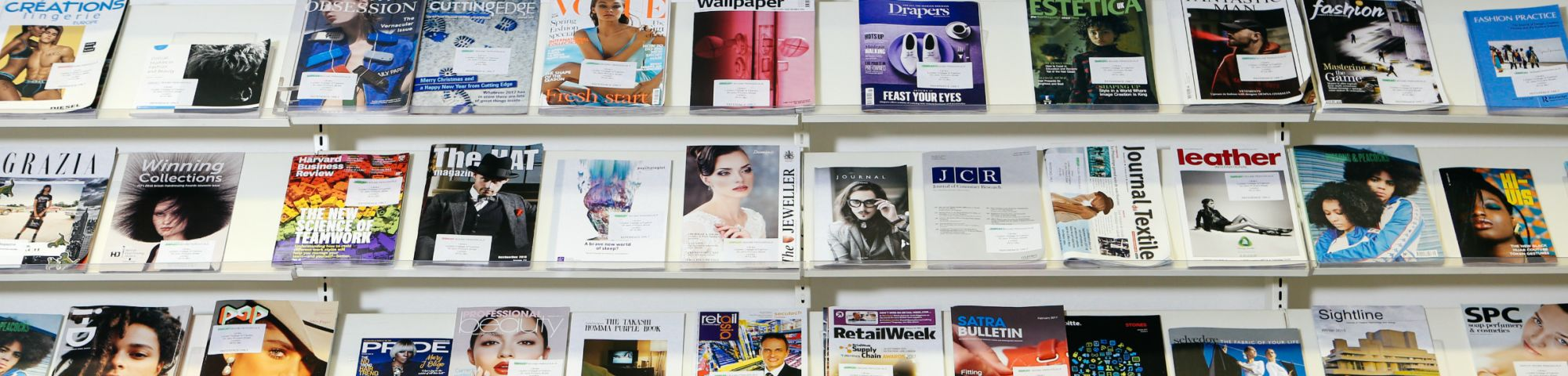 Collection of magazines displayed across a wall