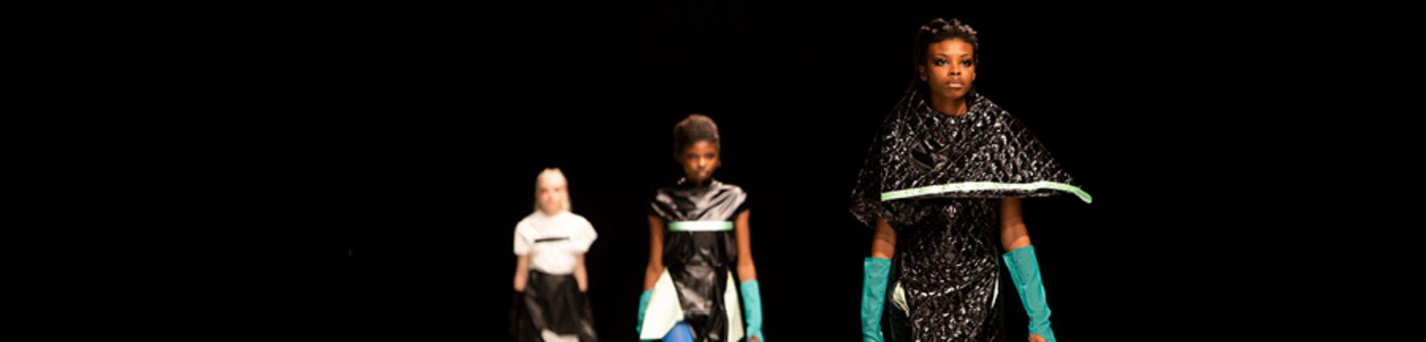 Models in striking designs on the runway