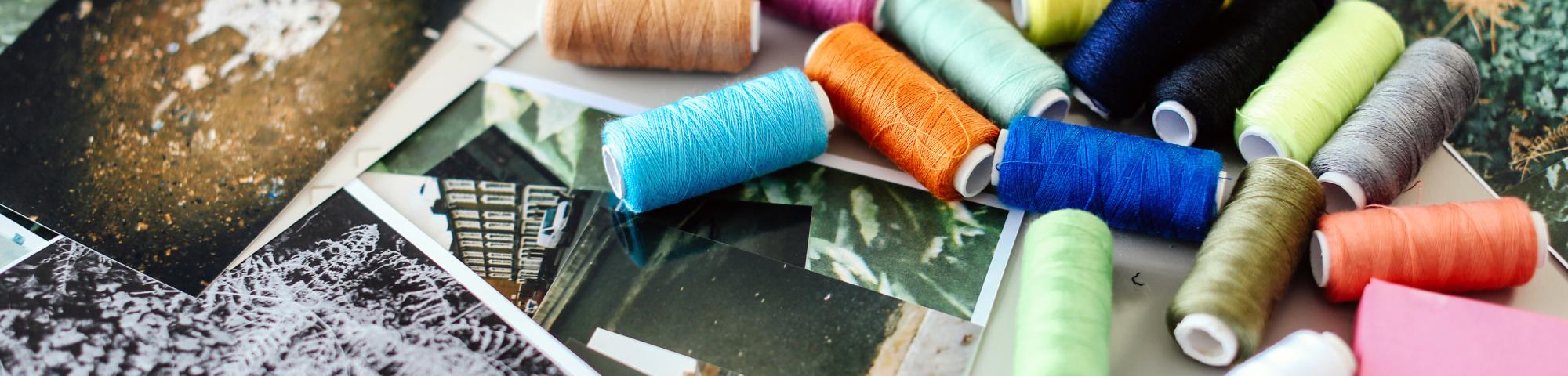 Thread and photographs on a table