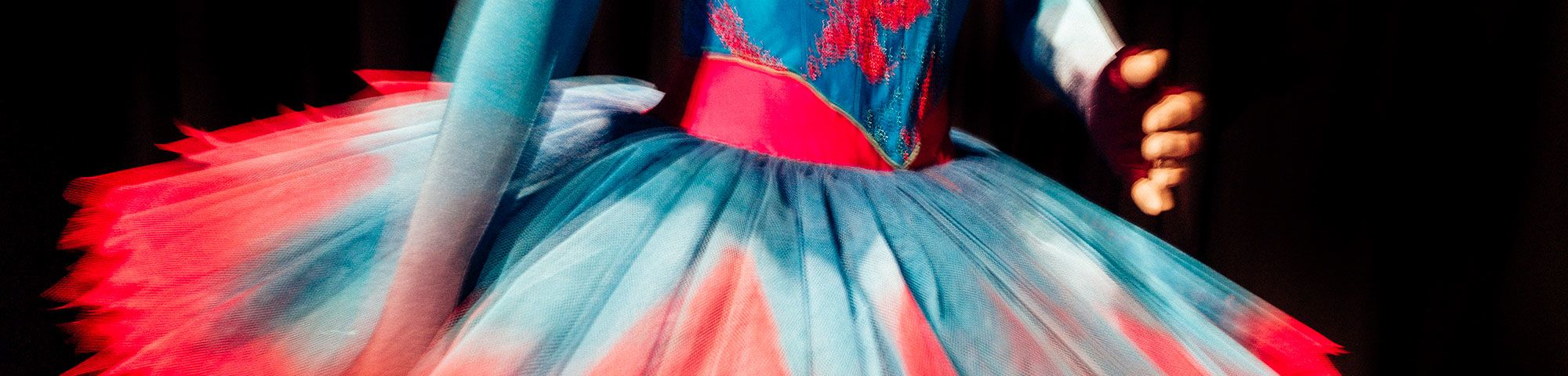 Dancer wearing red and blue costume.