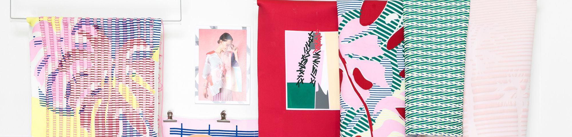 Selection of textile designs in reds, pinks and greens.