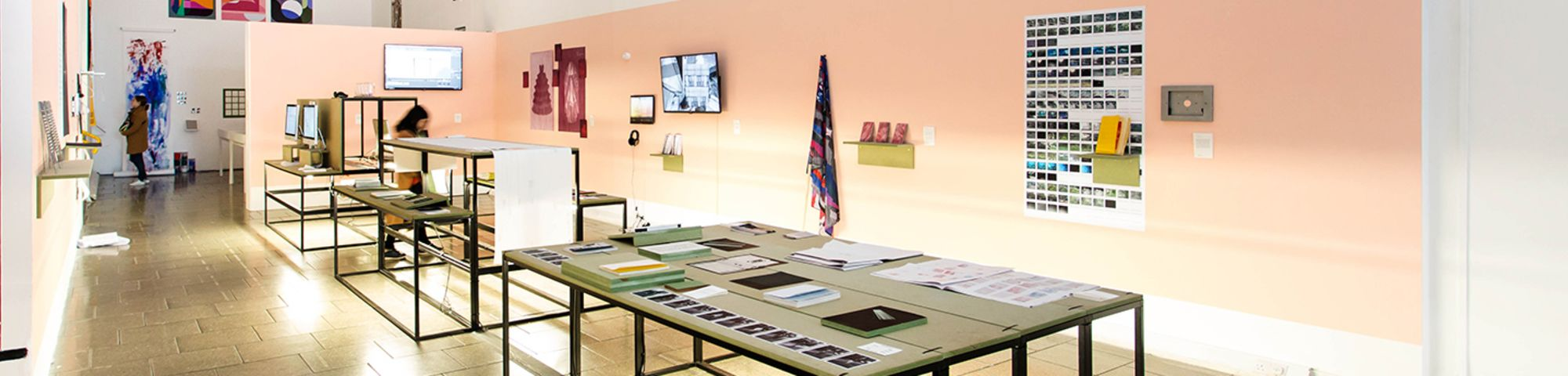 Exhibition view of a display table and other mounted work by MA Graphic Media Design