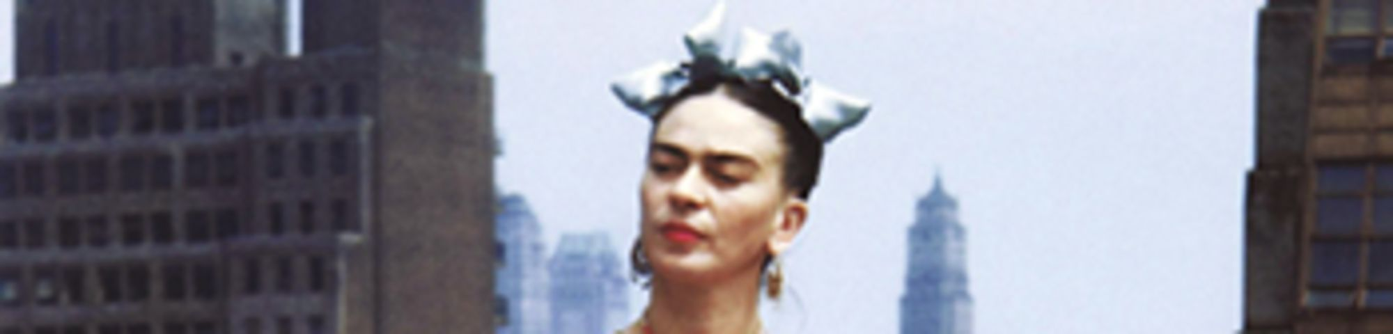 Kahlo in Tehuana dress on a New York City rooftop, 1939 by Nickolas Muray