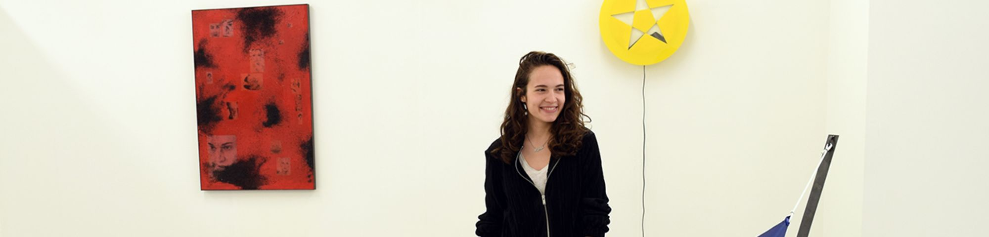 Marta Barina next to her degree work