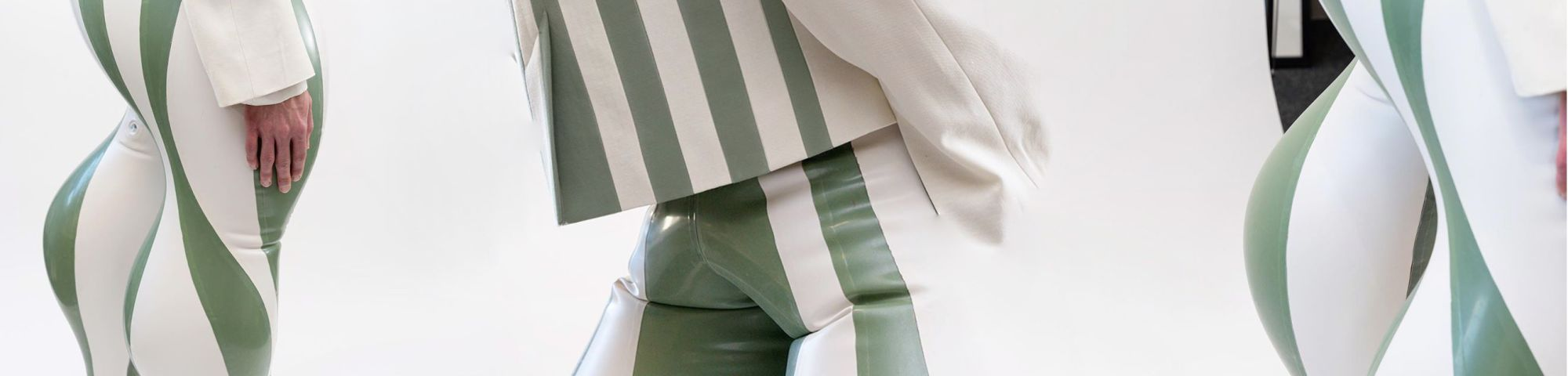 Models wearing striped inflatable latex trousers
