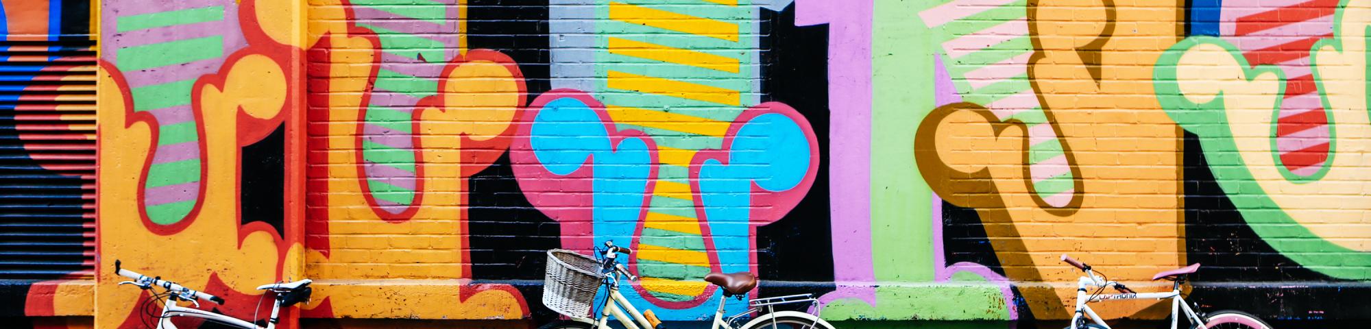 Bikes in front of graffiti