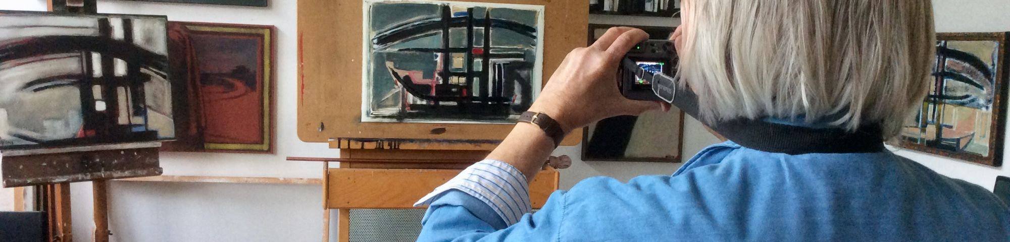 A picture of Andrew taking a photo of his work, in his studio