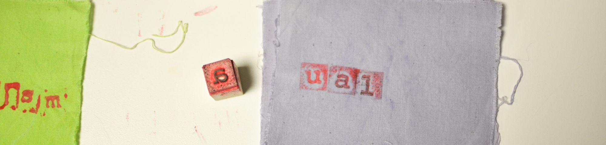 letter blocks and fabric bage with UAL spelled out
