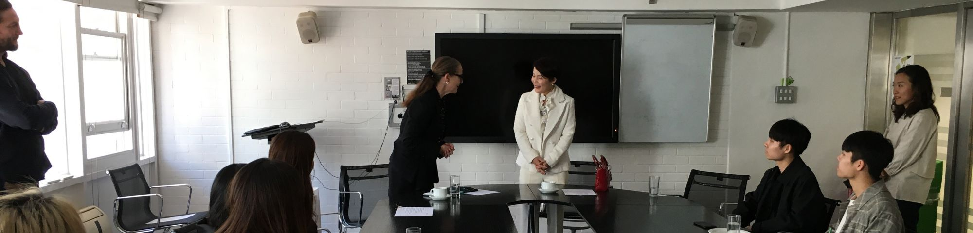 South Korean ambassador Enna Park meeting Professor Frances Corner and students at London College of Fashion, UAL