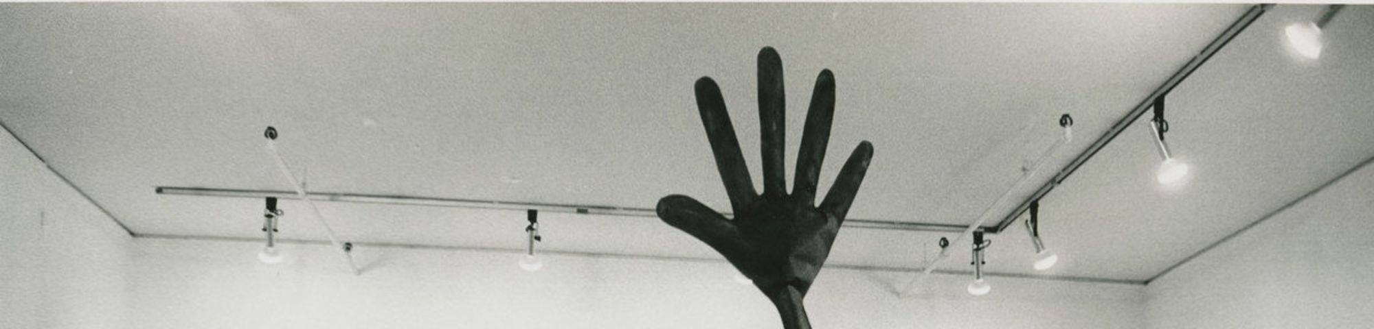 an art perfomance with gigantic gloves