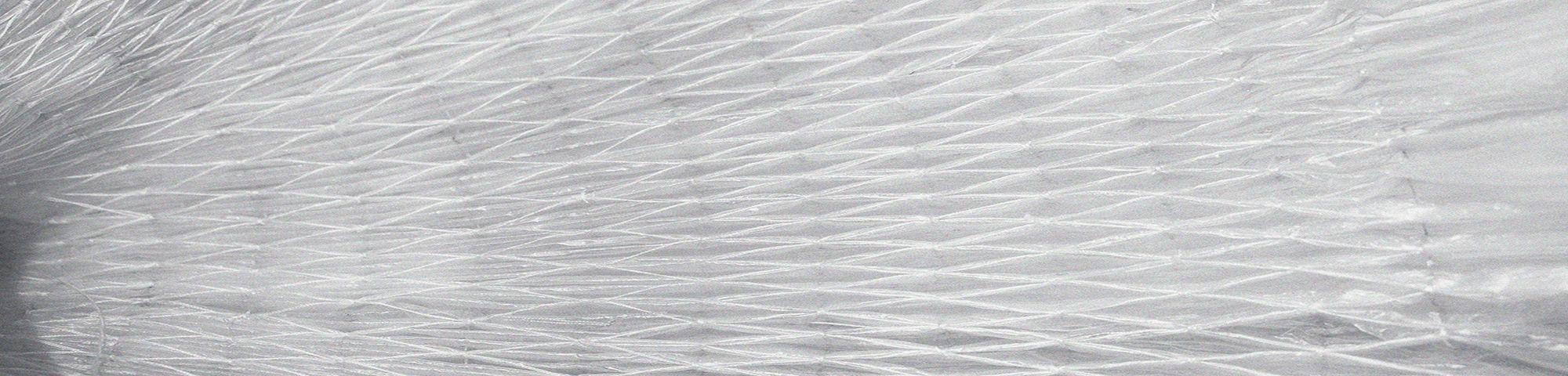 Close up of intricate plastic fabric