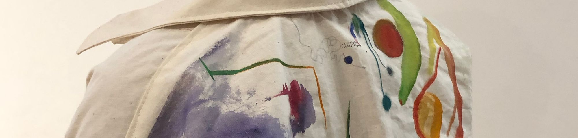 The view of a woman's back wearing a white jumpsuit which has been painted with Bauhaus-inspired designs, to be worn during the Bauhaus 100 performances in September 2019.