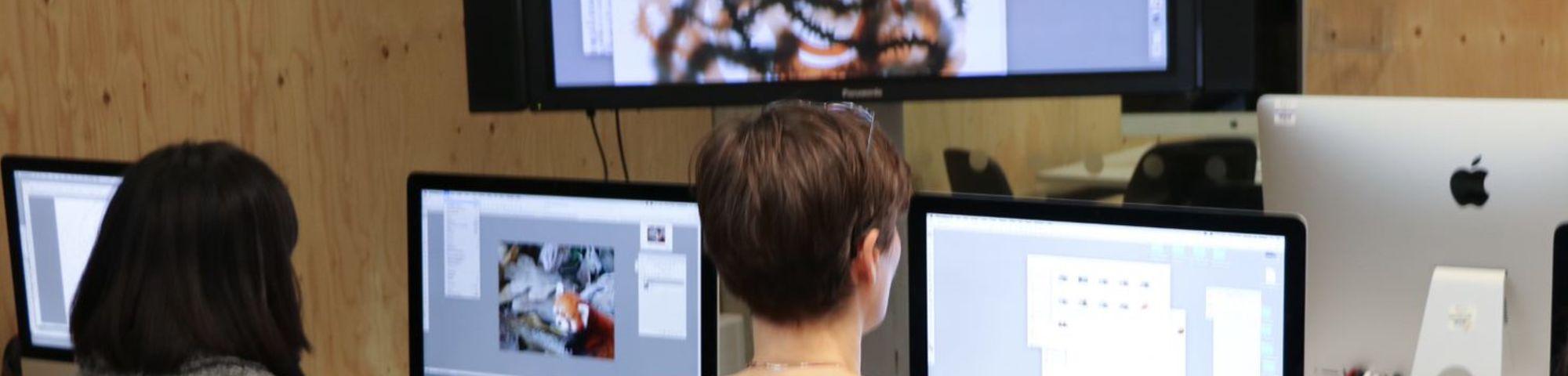 people looking at screens