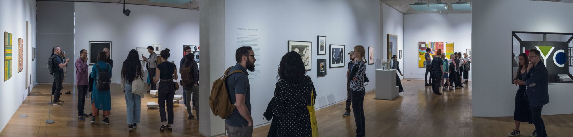 People looking at artworks in an exhibtion