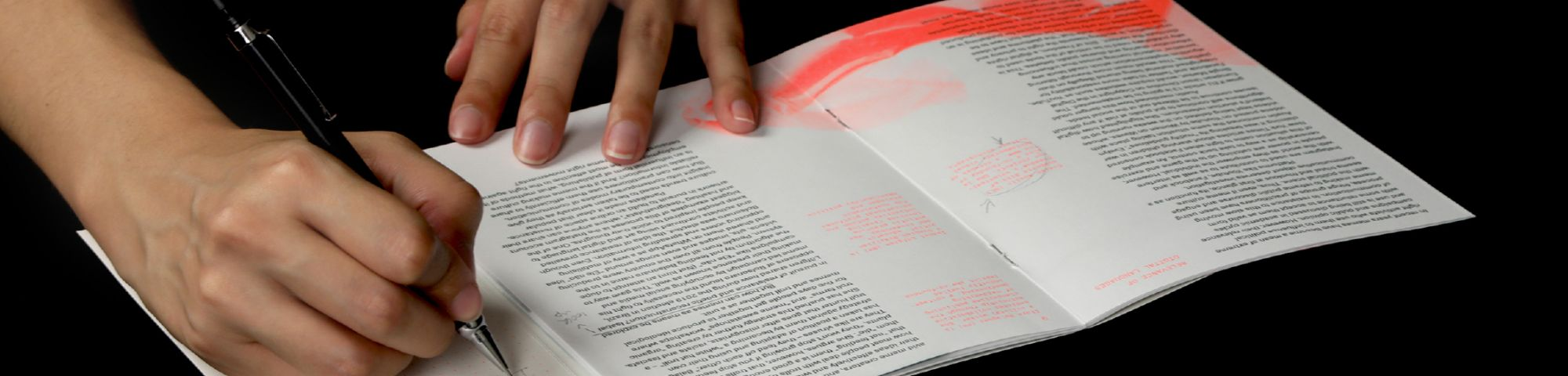 photograph of publication being written onto