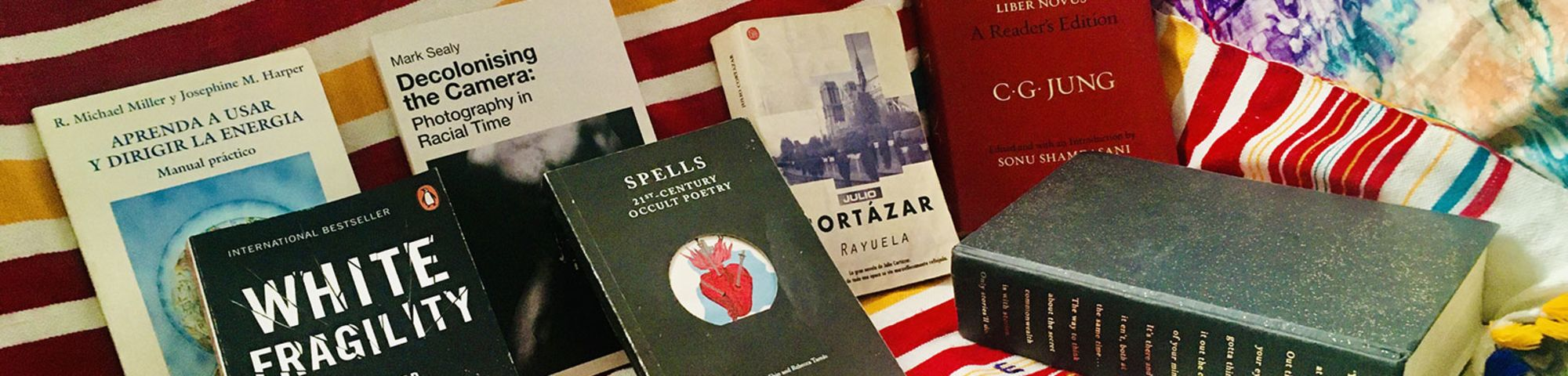 Ana's Bookshelf Picks arranged on a bright and colourful backdrop.