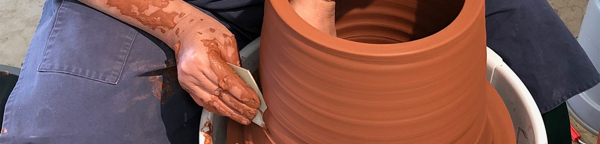 A man in the process of pottery