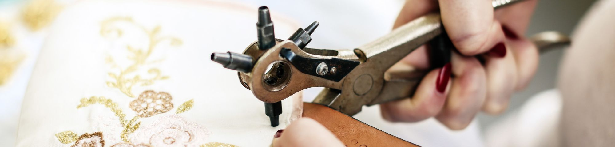 Close up shot of someone working on a pair shoes